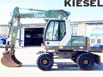 O&K MH City - wheel excavator